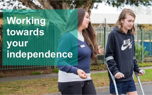 Image showing Independent Rehabilitation Services Physiotherapist with client on crutches